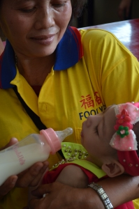 A baby taken care by a care-giver